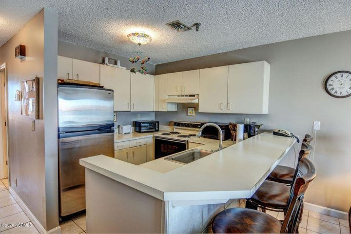 Great views all around from this top floor Villa Capriani Unit.  Priced to sell and looking for a new owner to complete repairs!  Updated kitchen.  2 bedroom and 2 bath unit with courtyard and ocean views.
