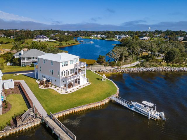 HUGE REDUCTION!!!  A great location - ICWW and walkable, golf cart, bike to downtown historic Swansboro! New Construction on the Intracoastal Waterway with million dollar views on coveted Deer Island Rd. True hardwood floors, impact windows and doors, granite and a chef's kitchen, grand master with ensuite.  Too many upgrades to list. Yes, there is an elevator and a whole house generator.  Private dock/lift for 28 foot boat.  Sold furnished. Change your life! Call for copy of floor plans and make an appointment today!