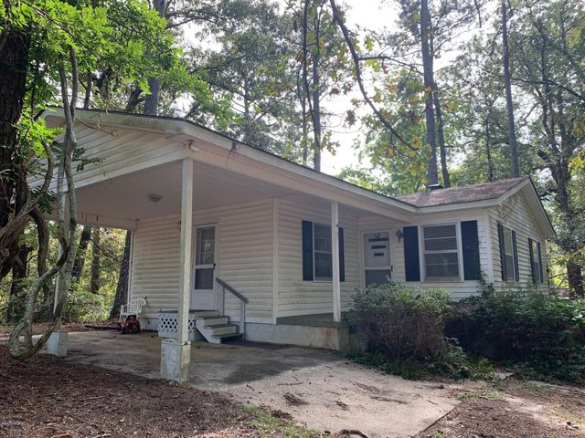 Complete privacy is yours with the 3 bedroom, 1 bath home on approximately 10.5 acres including all 3 parcels that convey at closing.  The back of the property comes up against Northeast Creek.  There is a separate huge storage shed behind the house.