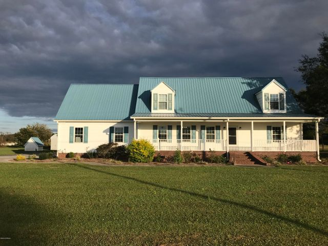 If you've ever wanted a small farm, some horses or just a garden, this 3-bed, 2 1/2-bath home on 3 1/2 acres is a great option in a convenient location. It is less than five miles from the conveniences of town, but out in the country. It's high and dry, but only three miles from fishing and boating on the Northeast Cape Fear River. It's also in the highly desirable Chinquapin School District! This home has a spacious kitchen and breakfast nook, with black GE, Kenmore and Whirlpool appliances, Corian countertops and a large island. Lots of cabinet space, and a pantry. Large master bed and bath has a jetted tub and separate shower, along with a walk-in closet. Upstairs bedrooms are spacious and share a full bath, along with a huge bonus room. An ADT security system is already in place so you can feel comfortable at home or away. Dual-zoned HVAC. Outdoor living space abounds with a 16' x 18' screened porch, a gracious 8' x 45' front porch just waiting for a swing, and a covered patio in back. A paved driveway and true two-car garage gives plenty of room for parking; and the wired 25' x 24' shop in the back yard has a garage door and a man door, so it's an excellent workshop. The house has been professionally landscaped, and there are even established and producing pecan trees on the property. Properties like this don't come around every day. Book your private showing now!