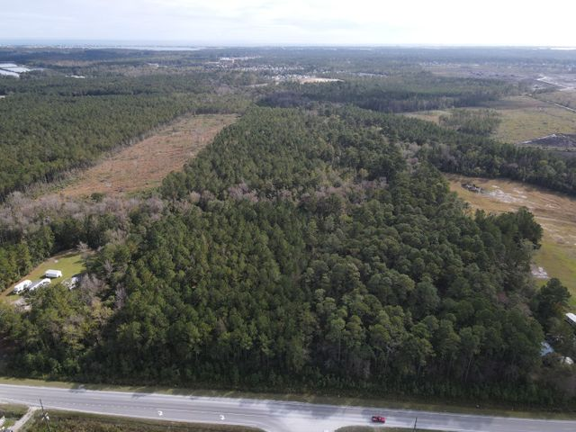 Now available-17 acres of land right off of Highway 172 in Sneads Ferry!! This wooded tract of land is in a highly desirable location, just a short drive to the military bases of Camp Lejeune, MCAS New River, North Topsail Beach, and to Hwy 17. It is the perfect place for a quaint community & is ready for its new owner!!