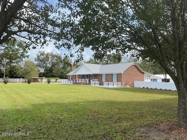 Pool, House & Workshop on 1.35 Acres! Beautiful one-of-a kind 3 bedroom brick home located in Richlands, not in a subdivision. Sprawling space both indoors and out. Large front and back covered porches. HUGE utility room, 23 x 9. Carport is 17 x 77. Detached garage and workshop measures 20 x 72. Please do not drive through patio area, septic lines are underneath. Just behind is 13.72 acres of Commercial Property and buildings also for sale.