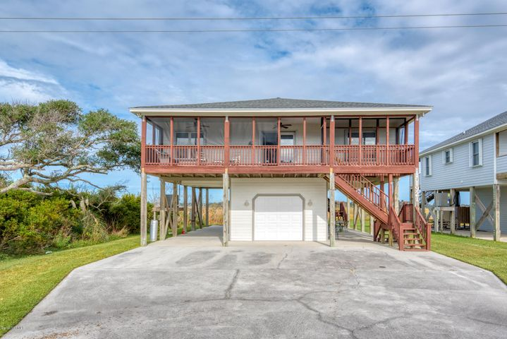 Ocean VIEWS..ICW VIEWS...Views from every window... Beautifully Remodeled...All on one level...new roof in 2019...new luxury Vinyl plank floors in 2019...kitchen features solid surface countertops, beautiful cabinets with lots of storage & soft close doors,..Spacious living area with vaulted ceiling... fireplace with gas logs...Remodeled master bath with tile shower, granite, double sinks and heated floor....lots of closets and storage space including walk in closet in the master bedroom... French doors lead to screened porches on the front and back plus a  sundeck... enjoy sun or shade ...relax on your porch and enjoy the gorgeous views and beautiful sunsets...there are storm shutters on all of the windows and doors...one car garage offers ample space for all of your beach toys, plus your car...close beach access...come enjoy Topsail Islands pristine sandy beaches and the beauty and of the sound side ...ready to move in...this property has never been a rental but is ready to rent if buyer prefers,...furnished with a short exemption list.