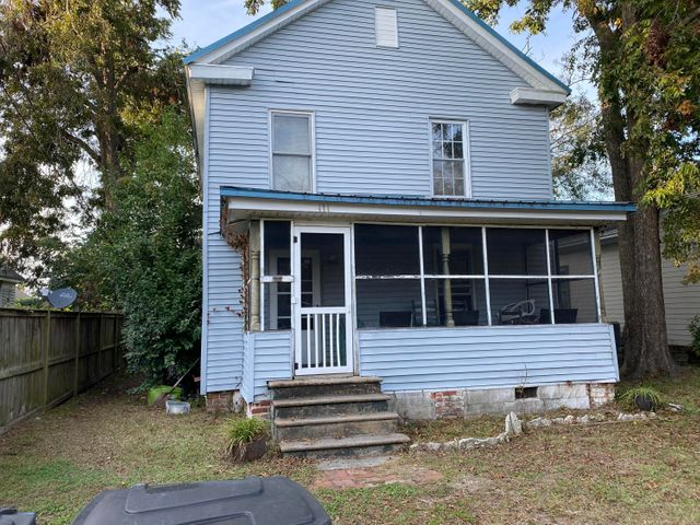 InVestors!!!!This historic home in downtown area is ready to be restored.  It features 4 bedrooms, 2 bathrooms and 2 kitchens(one upstairs and one downstairs).  It was built is 1905 and features a lot of original southern charm. Easily restored 2 family house layout.  TLC is much needed. Home is being sold as it.