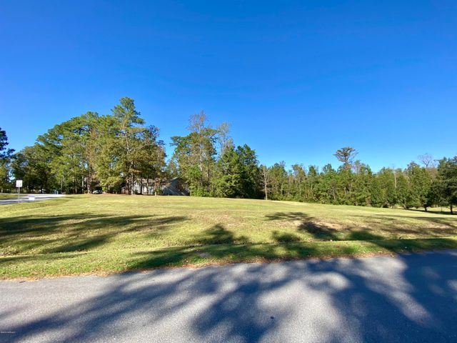 Build your custom dream home on this cleared .64 acre lot in Country Club! This gorgeous piece of property is situated on the corner of Country Club Drive and Greenway Road. The property is currently part of a 1.18 acre lot but owner will divide.  Call for more info!