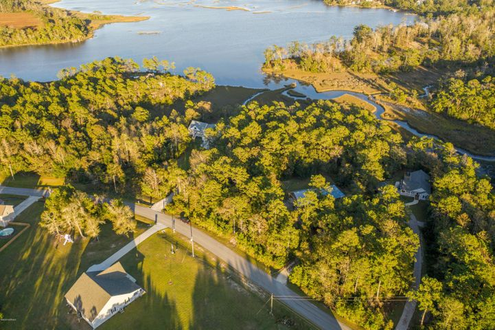 Lovely wooded, waterfront 2 acre lot in a quiet neighborhood. Build your dream home on this property and enjoy coastal living at its best, with the ICWW close by.  Lot has clear view of Mosley Creek and Pirates Bay.