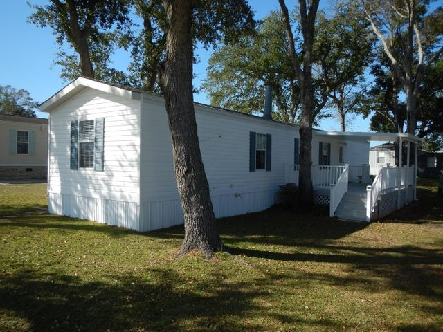 2002, FURNISHED,3BED/2BATH, IMPROVED HORTON, MOBILE HOME,WITH ENTRANCE PORCH,LARGE SIDE DECK, NEW SHINGLED ROOF INSTALLED, JANUARY 20, 2019,SEE DOCUMENTS, LOT HAS BEAUTIFUL,MATURE OAK TREES LOCATED IN GOOSE CREEK LANDING WHICH HAS SECURITY GATE, PAVED ROADS, UNDERGROUND UTILITIES,2 CONCRETE BOAT RAMPS,PIER/BOAT DOCK,COV.PICNIC AREA,CHILDRENS PLAYGROUND,BASKET BALL COURT, HORSESHOE PITS,SALT WATER SWIMMING POOL/BATH HOUSE.