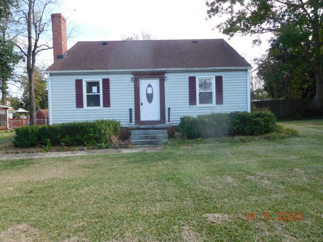 Adorable bungalow in downtown Richlands!  Living room with fireplace, kitchen with all appliances, formal dining room, 2 bedrooms and a full bathroom downstairs.  The upstairs is partially finished with a large bedroom or officer and another full bathroom.  Attached garage and gorgeous yard, too.  Call today for more information!