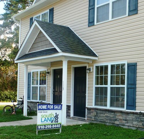 Lovely townhome right in town. City water/sewer. Walk to shopping. 2 bedroom / 2.5 bath townhome with laundry room closet off kitchen, gathering areas downstairs, spacious kitchen, 2 bedrooms upstairs each with its own bath. Screened-in back porch is perfect for your morning coffee! This well-maintained home was constructed in 2012 and has fresh paint throughout.