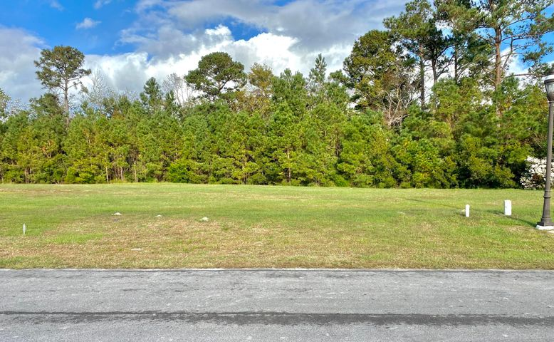 This is the land you've been waiting for!  This premier lot in the gorgeous low country resort community of Summerhouse is ready and waiting for you to make it your own.  You have to see this to believe it.  Nestled on a quiet street in this gated community, this prime piece of real estate is a quick walk or golf cart ride to some of the most unbelievable Intercoastal waterfront views.  The Summerhouse community has all the established amenities you could ever hope for, including a resort style pool, enormous club house, tennis courts, fitness center, day docks, boat storage, endless walking trails and so much more.  While there is plenty to keep you busy inside the neighborhood, this luxury community is just minutes away from Topsail or Wrightsville Beach and just a short drive from all the shopping, dining and entertainment that Wilmington & Jacksonville have to offer.  Municipal water and community sewer are available and this lot is cleared to make building a breeze. Wouldn't you like to own a piece of paradise?  It's like vacation every day here!  Come check out Summerhouse on Everett Bay today!