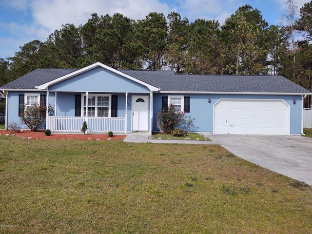 Great starter home close to the back gate of Camp Lejeune! As you pull into the neighborhood you realize just how close you are to Hammocks Beach State park, Emerald Isle, as well as the Pine Knoll Shores Aquarium and the list goes on. This home is perfectly located to all the fun the coast has to offer. Once in the drive, you immediately notice the charm of this home. There is a spot on the covered, front porch for your rocker to enjoy a cup of Lemonade on those nice summer days. Then as you enter the front door you feel the spaciousness of the living area which is situated just off the eat in kitchen.  There are three sizeable bedrooms and two full baths. As if this is not enough there is a two-car garage for your automobiles and large back yard for the rest of your entertaining. This home will not last! Bring your offers and make your dream a reality!
