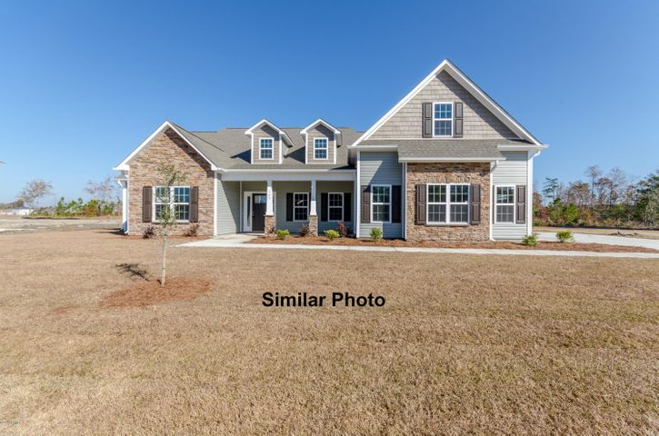 Welcome to Jacksonville's hottest new community, Stateside. Located off of Gum Branch Road behind Stateside Elementary School. All new construction by Onslow County's most trusted and preferred Builder featured in Builder 100/ Top 200 Home Builders in the country. Stateside is 16 miles to Camp Lejeune, 12 miles to New River Air Station and minutes to area schools and shopping. A beautiful new community for active and growing families. Upcoming community amenities will include clubhouse area and community pool.  Introducing the Massey 3196 floor plan... where luxury meets functional. Approximately 3196 heated square feet of charm, this brand new home is sure to impress. The covered front porch is waiting for your rocking chairs and hanging baskets. Invite your guests in to the grand foyer. The formal dining room is stunning and perfect for gathering family and friends. The expansive family room is open to the kitchen and breakfast nook. The family room boasts a trey ceiling, ceiling fan, and cozy electric fireplace surrounded by marble and topped with a custom mantle. The chef in the family will LOVE this kitchen. Flat panel, staggered cabinets (lots of them) granite counter-tops, and stainless steel appliances to include a smooth-top range, dishwasher, and microwave hood. The kitchen is also open to the breakfast nook, a place to enjoy your morning coffee, or have breakfast with the family. The master suite comes complete with a trey ceiling, ceiling fan, and access to the back covered patio. The master bathroom boasts a double vanity topped with cultured marble counters, full view custom mirror, ceramic tile flooring, and a separate shower and soaking tub. The master bathroom leads to a huge walk-in-closet and through the walk-in-closet is the 2nd entrance to the laundry room, how convenient. Across the home you will find bedrooms 2 and 3, that share a Jack-and-Jill bathroom with linen closet. A fourth bedroom/optional study is found at the front of the home. Stair