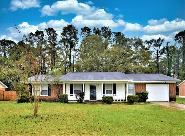 This charming home is in need of some TLC to make it shine like new.  So much potential!3 bedrooms, 2 baths and a large backyard.This home is within minutes of Camp Lejeune, restaurants, schools, and shopping.Roof replaced in 2014Applianced and carpeting replaced in 2016New back door in garage replaced in 2019A/C Heat pump replaced in 2019Water Heater 40gal replaced in 2020