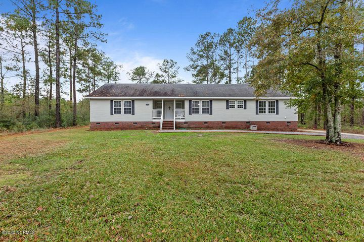 Check out this gorgeous home tucked away in the privacy of a large, wooded lot, just on the outskirts of Jacksonville. You will fall in love with the huge rooms, cozy fireplace, upgraded kitchen, and high end finishes. The unique floorplan features four large bedrooms and three full baths! The master bedroom features two great sized walk-in closets, and a huge attached bath with a soaking tub, walk-in shower, and dual vanities. The kitchen features stainless steel appliances, tons of cabinet space, and a massive kitchen island perfect for food prep and entertaining. You won't want to miss this beauty...schedule your showing before its too late.