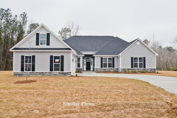 Welcome to the prestigious new home community, The Preserve at Tidewater. A coastal community. Brand new homes by Onslow County's most trusted and preferred builder, featured in Builder 100/ Top 200 Building firms in the country. This prominent neighborhood boasts a picturesque entrance, matured trees, spacious lots and a feeling of nature and serenity. Complete with an impressive clubhouse area and community pool. Introducing the Grant floor plan at approximately 3181 heated square feet offers 3 bedrooms and 3 bathrooms, a bonus room, sitting room in the master suite, living room, family room......and more! The outside is complete with vinyl siding, accented by stone or brick, with a sodded front yard. The foyer welcomes you in to the formal dining room and living room. Down the hall you will find the AMAZING master suite with large sitting room. The master suite comes complete with a trey ceiling, ceiling fan, and a large master bathroom. The master bathroom features two vanities topped with cultured marble and custom mirrors, water closet, separate shower and soaking tub, follow through to your DREAM master walk-in-closet., space and more space. After you've relaxed all your stress away in the master bathroom, be sure to relax in the master bedroom sitting area, where you are sure to have peace and quiet. Bedrooms 2 and 3 are perfectly sized, and pre-wired for ceiling fans. Bedroom 2 has it's own bathroom. Back down the hall and through the living room you will come upon the kitchen and breakfast nook. The kitchen is sure to please the chef in the family with flat paneled cabinets, granite counter tops, stainless steel microwave hood, flat top range, dishwasher, and island. Enjoy your morning cup of Joe in the breakfast nook, while over looking the approximately 18x22 family room. The family room is complete with ceiling fan, and lovely fireplace surrounded by marble and topped with a custom mantle. Don't forget about the bonus room over the garage, the perfect place for a home theatre, game room, toy room, office, exercise room...........so many possibilities, you decide!! Wander out back to your covered patio, the absolute perfect setting for those BBQ's and Carolina evenings. The two car garage, what better place to protect your cars from the weather. All backed by a one-year builder warranty from a top, local builder. NOTE: Floor plan renderings are similar and solely representational. Measurements, elevations, design features, among other items may vary in final construction. Call to verify. Welcome Home.