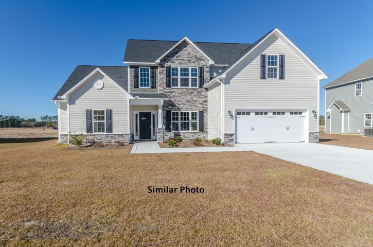 Welcome to the prestigious new home community, The Preserve at Tidewater. A coastal community. Brand new homes by Onslow County's most trusted and preferred builder, featured in Builder 100/ Top 200 Building firms in the country. This prominent neighborhood boasts a picturesque entrance, matured trees, spacious lots and a feeling of nature and serenity. Complete with an impressive clubhouse area and community pool. Introducing the Berkley floor plan which boasts with 5 bedrooms and 3.5 bathrooms at approximately 2920 heated square feet. The outside comes equipped with easy to maintain vinyl siding, accented by stone or brick, with a sodded front yard.  Welcome your guests into your home in your two story foyer.  The formal dining room is the perfect place to gather for special events and family meals.  The chef in the family is sure to fall in love with the kitchen.  Flat panel staggered cabinets, large pantry, an island for food preparation and a stainless steel appliance package to include the dishwasher, microwave hood, and smooth top range.  Enjoy your morning cup of joe in the open breakfast nook.  Movie nights made simple in the large family room.  Complete with ceiling fan and lovely fireplace surrounded by marble and topped with a custom mantle. Convenient first floor master suite allows for privacy and relaxation.  The master suite features a trey ceiling, ceiling fan, and master bathroom.  The master bathroom includes a double vanity with cultured marble counters and custom mirror, water closet, separate shower and soaking tub.  Follow through the master bathroom to the ENORMOUS master walk-in closet.  Upstairs you will find the remaining 4 bedrooms and 2 bathrooms, all perfectly sized and pre-wired for ceiling fans.  Bedroom 5 has it's very own sitting area.  Wander outside to your covered back patio, the perfect place to gather for BBQ's or those warm Carolina evenings. Your two car garage is the perfect place to keep your vehicles safe from the weather.  All backed by a one-year builder warranty, from a top local builder. NOTE: Floor plan renderings are similar and solely representational. Measurements, elevations, and design features among other things, may vary in the final construction. Call to verify. Buyer to verify schools. Welcome Home.