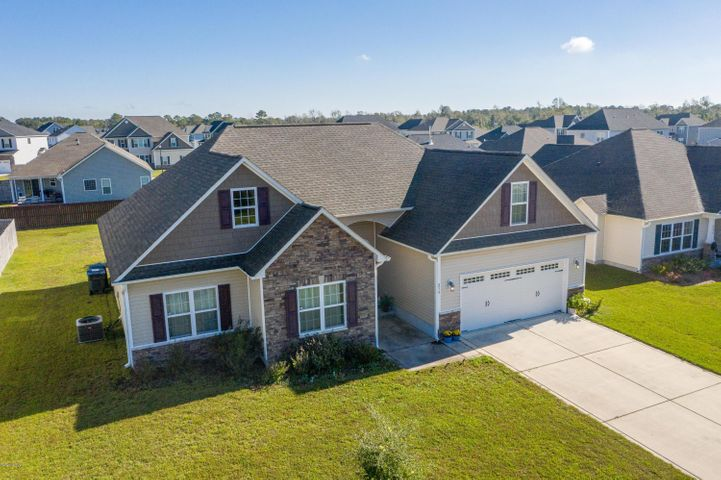 This beautiful 3 bedrooms, 2 bathrooms, and a bonus room is located at Nautical Reach Home Community in Sneads Ferry. This home offers an open foyer that welcomes you to a spacious open living room, the bonus room and master bedroom to your left, and the other 2 bedrooms to your right. Minutes to the beaches of Topsail Island. Convenient and proximity to the back gate of Camp Lejeune, and a short drive to New River Air Station, Jacksonville, Surf City, and Wilmington.
