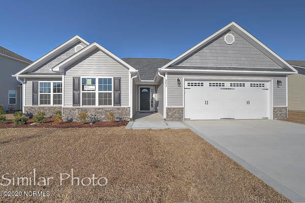 Welcome to Jacksonville's hottest new community, Stateside. Located off of Gum Branch Road behind Stateside Elementary School. All new construction by Onslow County's most trusted and preferred Builder featured in Builder 100/ Top 200 Home Builders in the country. Stateside is 16 miles to Camp Lejeune, 12 miles to New River Air Station and minutes to area schools and shopping. A beautiful new community for active and growing families. Introducing the Vienna 1788 which features 3 bedrooms and 2 baths at approximately 1,788 heated square feet. The exterior is quite charming with easy-to-maintain vinyl siding, accented by stone or brick. All surrounded by a sodded front yard with a clean, classic landscape. Concrete driveway and sidewalk lead you up to a welcoming front door, opening to a large foyer. The family room, approximately 18'x21' is perfect for gathering everyone together for movie night! Complete with a vaulted ceiling, ceiling fan, and a cozy electric fireplace surrounded by marble and topped with a custom mantle. The chef in the family is sure to fall in love with the kitchen. Flat panel, staggered cabinets, a bar for extra seating, and a pantry for extra storage. Stainless appliances include a smooth-top range, microwave hood and dishwasher. Kitchen opens to the dining room. The master suite, approximately 18'x12' features a ceiling fan and a huge walk-in-closet. ''Get away from it all'' in the luxurious master bathroom. Double vanity topped with cultured marble counters, full view custom, ceramic tile flooring, separate shower and soaking tub. Bedrooms 2 and 3 are perfectly sized and prewired for ceiling fans. Enjoy those Carolina evenings on the open patio! All backed by a one-year builder warranty from a top, local builder. Call today! NOTE: Floor plan renderings are similar and solely representational. Measurements, elevations and design features, among other things, may vary in the final construction. Call to verify. Welcome Home.