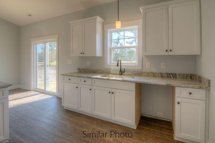 Welcome to the Southport in charming Sneads Ferry. The Southport floor plan is sure to impress with 3 bedrooms, 2 baths and a bonus/study. As if that isn't enough, Bumps Creek is located less than 5 minutes away from area beaches, waterfront dining, and multiple public boat ramps. Camp Lejeune, & Stone Bay under 10 Minutes. Builder is offering $3000 use as you choose. Don't wait, schedule your tour today!