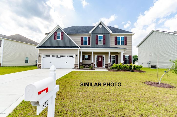 Welcome to Jacksonville's hottest new community, Stateside. Located off of Gum Branch Road behind Stateside Elementary School. All new construction by Onslow County's most trusted and preferred Builder featured in Builder 100/ Top 200 Home Builders in the country. Stateside is 16 miles to Camp Lejeune, 12 miles to New River Air Station and minutes to area schools and shopping. A beautiful new community for active and growing families. Upcoming community amenities will include clubhouse area and community poolIntroducing the Lockhart floor plan which offers 4 spacious bedrooms and 2.5 bathrooms as approximately 2,401 heated square feet. The exterior is quite charming with easy-to-maintain vinyl siding, accented by brick or stone. The covered front porch is waiting for your rocking chairs and hanging baskets. All surrounded by a sodded front yard with a clean, classic landscape. The 2-story foyer makes a grand entrance. Open and spacious, the chef in the family will certainly fall in love with the kitchen! Flat panel, staggered cabinets topped with modern granite counters, an island and pantry. Stainless appliances include a smooth-top range, microwave hood, and dishwasher. Enjoy your morning coffee in the cozy breakfast nook. The formal dining room and formal living room are ideal for hosting those special occasions such as birthdays, holidays, etc. Gather the entire family for movie or game night in the expansive family room. Approximately 17'x13' with a ceiling fan and electric fireplace, surrounded by marble and topped with a custom mantle. Large, separate laundry room found on first floor. All bedrooms are found upstairs. The master suite is approximately 18'x13' with an additional 7'x10' sitting area. Complete with a ceiling fan and an alluring trey ceiling. ''Get away from it all'' in the luxurious master bathroom. Double vanity topped with cultured marble, ceramic tile flooring, full view custom mirror, separate shower and soaking tub, and leads to a huge walk-in-closet. Bedrooms 2, 3, and 4 are perfectly sized and prewired for ceiling fans. Entertain all summer long on the covered back porch. 2 car garage. All backed by a one-year builder warranty from a top, local builder. Call today! NOTE: Floor plan renderings are similar and solely representational. Measurements, elevations, and design features, among other items, may vary in the final construction. Call to verify. Welcome Home.