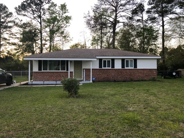 Located right outside the city limits sits this cozy gem. Updated, from flooring to appliances, paint and carpet. You'll just love this 3 bedroom 2 bath fully fenced in  home! The pictures speak for itself.