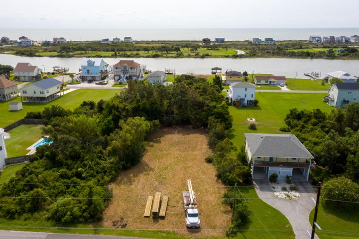 Brand new construction in Sneads Ferry where there are no city taxes and NO HOA DUES! Home projected completion is early February. Purchase this Single Family Home located on stilts to enjoy the intracoastal waterway view! Home will have all bedrooms and living areas on the main level. Covered Porches, wrap around decks, and a concrete parking area are just a few of the amazing items that you will enjoy living the coastal life. Great location in Sneads Ferry to enjoy living off the beaten path, but close enough to get to Topsail Island or Camp Lejeune a hop, skip, and jump away!  Custom Kitchen cabinets, laminate flooring, and tile bathrooms will dazzle your senses and put you on the feel good ride to come home! Set up your family in this home that is over 2000 sq feet of brand new coastal beauty located on a large lot! If you enjoy 9ft ceilings, walk in closets, and want to have the luxury of a kitchen pantry, this is your next home!