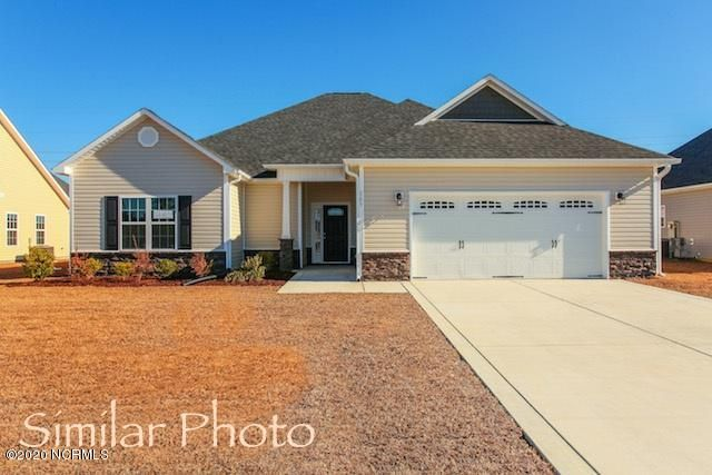 Welcome to Jacksonville's hottest new community, Stateside. Located off of Gum Branch Road behind Stateside Elementary School. All new construction by Onslow County's most trusted and preferred Builder featured in Builder 100/ Top 200 Home Builders in the country. Stateside is 16 miles to Camp Lejeune, 12 miles to New River Air Station and minutes to area schools and shopping. A beautiful new community for active and growing families. Upcoming community amenities will include clubhouse area and community pool.Introducing the Raegan floor plan. Featuring 3 spacious bedrooms and 2 bathrooms at approximately 1,916 heated square feet.  The exterior is quite charming with easy-to-maintain vinyl siding accented by stone or brick. All surrounded by a sodded front yard with a clean, classic landscape. The foyer welcomes you in, opening into the expansive family room. Approximately 23'x18', the family room is perfect for gathering the entire family for movie or game night. Complete with a vaulted ceiling, ceiling fan, and an electric fireplace situated in the corner, surrounded by marble and topped with a custom mantle. The chef in the family is sure to fall in love with the kitchen! Flat panel, staggered cabinets topped with modern counters. Stainless appliances include a smooth-top range, microwave hood, and dishwasher. The spacious dining area is open to the kitchen. The master suite is located on the opposite end of bedrooms 2 and 3 for extra privacy. Approximately 17'x13', the master bedroom boasts a ceiling fan, trey ceiling, and his & her walk-in-closets. Unwind after a long day in the luxurious master bathroom. Double vanity topped with cultured marble counters, full view custom mirror, ceramic tile flooring, separate shower and soaking tub. Bedrooms 2 and 3 are approximately 13'x13' with walk-in-closets and prewired for ceiling fans. Enjoy those Carolina evenings on the covered patio. 2 car garage. All backed by a one-year builder warranty from a top, local builder. Call today! NOTE: Floor plan renderings are similar and solely representational. Measurements, elevations, and design features, among other things may vary in the final construction. Call to verify. Welcome Home.