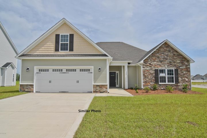 Welcome to the prestigious new home community, The Preserve at Tidewater. A coastal community. Brand new homes by Onslow County's most trusted and preferred builder, featured in Builder 100/ Top 200 Building firms in the country. This prominent neighborhood boasts a picturesque entrance, matured trees, spacious lots and a feeling of nature and serenity. Complete with an impressive clubhouse area and community pool. Introducing the Riley floor plan which offers 3 bedrooms, 2 bathrooms, and a bonus room, at approximately 2560 heated square feet. The exterior is quite charming with easy-to-maintain vinyl siding accented by stone or brick. All surrounded by a sodded front yard with clean, classic landscaping. The foyer welcomes you in, opening into the expansive family room. Approximately 18'x25', the family room is perfect for gathering the entire family for movie or game night.  The family room is equipped with a ceiling fan and a lovely fireplace situated in the corner of the room, surrounded by marble and topped with a custom mantle, it's the perfect place to cozy up next to on those chilly winter evenings.  The chef in the family is sure to fall in love with the kitchen! Flat panel, staggered cabinets topped with granite counter tops, the kitchen is also furnished with stainless appliances to include a smooth-top range, microwave hood, and dishwasher. The spacious dining area is open to the kitchen. The master suite is located on the opposite end of bedrooms 2 and 3 for extra privacy. Approximately 17'x18', the master bedroom boasts a ceiling fan, trey ceiling, and two walk-in-closets. Unwind after a long day in the luxurious master bathroom. Double vanity topped with cultured marble counters, full view custom mirror, ceramic tile flooring, separate shower and soaking tub. Bedrooms 2 and 3 are perfectly sized with their own walk-in-closets and prewired for ceiling fans. The large bonus room, approximately 12'x26', can be used for many purposes, office, gym, tv room