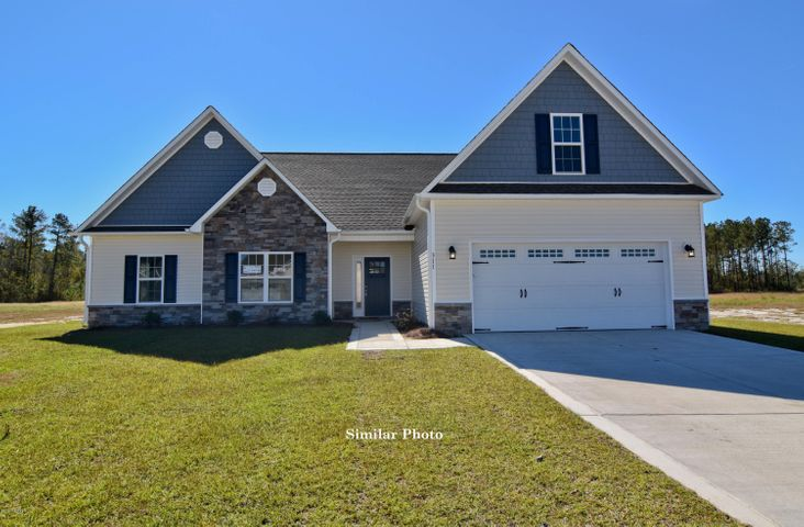 Welcome to the prestigious new home community, The Preserve at Tidewater. A coastal community. Brand new homes by Onslow County's most trusted and preferred builder, featured in Builder 100/ Top 200 Building firms in the country. This prominent neighborhood boasts a picturesque entrance, matured trees, spacious lots and a feeling of nature and serenity. Complete with an impressive clubhouse area and community pool.  Introducing the Sutton floor plan. Featuring 3 spacious bedrooms and 3 bathrooms at approximately 2,283 heated square feet.  The exterior is quite charming with easy-to-maintain vinyl siding accented by stone or brick. All surrounded by a sodded front yard with a clean, classic landscape. The foyer welcomes you in, in to a lovely, open living space. At approximately 16'x18'', the living room is perfect for gathering the entire family for movie or game night. Complete with a double trey ceiling, ceiling fan, and a fireplace situated in the corner, surrounded by marble and topped with a custom mantle. The chef in the family is sure to fall in love with the kitchen! Flat panel, staggered cabinets topped with modern granite counters. Stainless appliances include a smooth-top range, microwave hood, and dishwasher. The spacious dining area is open to the kitchen. The master bedroom is approximately 15'x14' and features a ceiling fan, trey ceiling, and walk-in-closet. Unwind after a long day in the luxurious master bathroom. Double vanity topped with cultured marble counters, full view custom mirror, ceramic tile flooring, separate shower and soaking tub. Bedrooms 2 and 3 are approximately 11'x13' and 12'x12' with double closets and prewired for ceiling fans. Enjoy those Carolina evenings on the covered patio. 2 car garage. All backed by a one-year builder warranty from a top, local builder. Call today! NOTE: Floor plan renderings are similar and solely representational. Measurements, elevations, and design features, among other things may vary in the final con