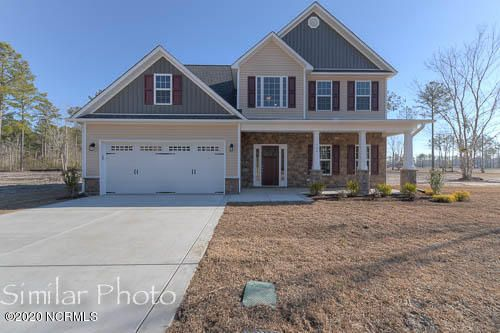 Welcome to Jacksonville's hottest new community, Stateside. Located off of Gum Branch Road behind Stateside Elementary School. All new construction by Onslow County's most trusted and preferred Builder featured in Builder 100/ Top 200 Home Builders in the country. Stateside is 16 miles to Camp Lejeune, 12 miles to New River Air Station and minutes to area schools and shopping. A beautiful new community for active and growing families. Upcoming community amenities will include clubhouse area and community pool.Introducing the Catalina floor plan which features 4 bedrooms and 2.5 bathrooms at approximately 2,278 heated square feet. The curb appeal is exquisite with easy-to -maintain vinyl siding, accented by stone or brick and a sodded front yard with classic landscaping. The covered front porch is waiting for your rocking chairs and hanging baskets. The grand, 2-story foyer welcomes you in, opening to the formal dining room, perfect for hosting those special occasions. The chef in the family is sure to fall in love with the kitchen! Open and spacious with an ample amount of cabinet and counter space, a bar for extra seating, stainless smooth-top range, microwave hood, and dishwasher. Enjoy your morning coffee in the breakfast nook. Gather everyone together for movie or game night in the family room. An expansive 20'x15', the family room boasts plenty of natural lighting, a ceiling fan to help cool off during those hot Carolina summers or snuggle up to the cozy electric fireplace, surrounded by marble and topped with a custom mantle. The impressive master suite is approximately 17'x16' with a trey ceiling and ceiling fan. ''Get away from it all'' in the luxurious master bathroom. Complete with a double vanity topped with cultured marble counters, full view custom mirror, ceramic tile flooring, separate shower and soaking tub......all leading to a HUGE walk-in-closet - you must see to believe!! Bedrooms 2, 3, and 4 are perfectly sized and prewired for ceiling fans. Ove