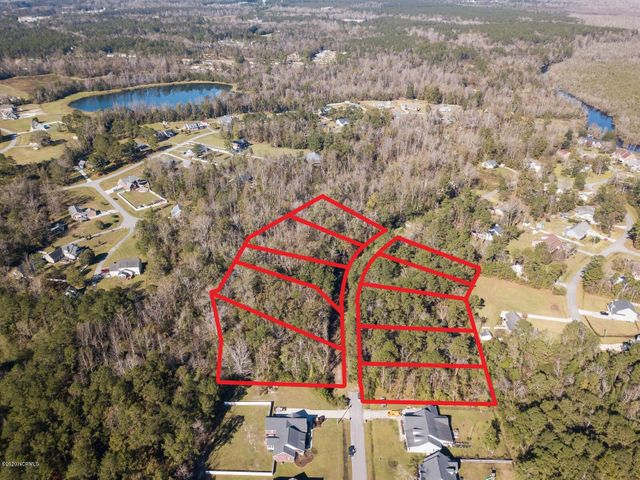Builder or Investor Package on these  undeveloped lots on the southwest side of Jacksonville NC! Totaling over 4.4 acres, this parcel is not in city limits, and has minimal protective covenants but NO HOA! The seller had topo and boundary surveys completed, as well as soil evaluations, and there are several options for home site locations. The lots on the west side back up to Flat Bottom Branch, and there is some flood hazard area on the back side of the lots, but there is high land to work with! These lots are zoned R-15, but maybe you just want to recombine them and have some privacy. Or if you are a builder, put some spec homes up with good floorplans priced right and they will sell with this awesome location. Candlewood is a state maintained road, according to the DOT website, so there may be hope for this section of unpaved, undeveloped road to be taken over by the state if improved. Call a Realtor today for more information on this opportunity!