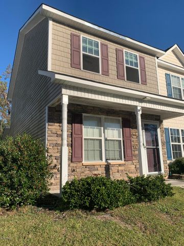 Cute Townhome in the Private Community of Doris Place just off Gum Branch Road.  Walk inside into the Living area with premium laminate flooring.  The Kitchen has granite counter tops, SS appliances and white cabinets.  Just off the Kitchen is your laundry area.  Walk out the back door and enjoy a cold drink on your screened in porch with storage room. Upstairs are two bedrooms with ample closets, a full bath with garden tub, dual vanities with granite countertop and linen closet. This home is walking distance to Restaurants, shopping and a short commute to Camp Lejeune. This won't last long at this price.