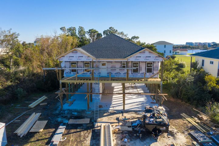 Brand new construction in Sneads Ferry where there are no city taxes! Purchase this Single Family Home located on stilts to enjoy an intercoastal waterway view and NO HOA FEES! Home will have all bedrooms and living areas on the main level.  A covered deck on the front of the home to enjoy nature while watching for deer and wildlife, and a covered deck on the back to enjoy views of the intercoastal waterway and a great size backyard! There is a concrete parking area under the home for you to add your picnic tables, store your watercraft toys, or simply have a workspace out of the dirt! Closed in Storage to secure those bikes or tools, and trex decking with vinyl rails for low, long life stability. These are just a few of the amazing items that you will enjoy living the coastal life at this awesome custom built home with an amazing floor plan. Great location in Sneads Ferry to enjoy living off the beaten path, but close enough to get to Topsail Island or Camp Lejeune a hop, skip, and jump away!  Custom Kitchen cabinets, custom built pantry, extra large master closet, cultured marble showers, quartz countertops, laminate flooring throughout the entire home with no carpet, and tile bathrooms will dazzle your senses and put you on the feel good ride to come home! Set up your family in this home that is over 2000 sq feet of brand new coastal beauty located on a large lot with a privacy wooded edge for you to customize your own way! If you enjoy 9ft ceilings, crown molding, and want to have the luxury of a custom built kitchen, and optimized usable sq ft this is your next home! Home is projected to be completed by the end of February beginning of March. Feature List available for all the fantastic upgrades this home is going to have. Flooring, Cabinets, fixtures have been picked out and samples are available for you to view!