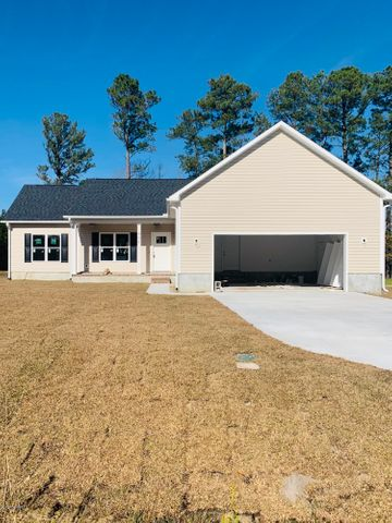 Are you looking for a new construction home in a peaceful, country setting and with no HOA? Here it is! This wonderful three bedroom, 2 bath layout has a terrific flow. The main living area is wide open for comfort and convenience. The kitchen is just perfect for any cook and the cabinets are GORGEOUS! The split floorplan provides privacy with the owner's suite to one side and the secondary bedrooms and second full bath to the other. There are even two ways to access the secondary rooms so everyone has quick access from the living areas to any other room in this home. The outside is just as lovely as the inside with lots of trees for privacy and shade. Do not miss your chance to make this BRAND NEW house your new home!