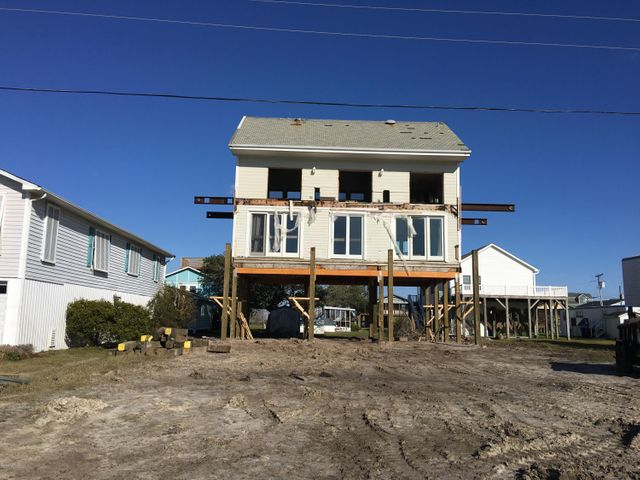 A unique opportunity to own a home on beautiful Topsail Island in a very desirable location. The house has been relocated onto 8020 Eighth Street Surf City.  The house is now on pilings and  seller will begin the remodel that will make this home a great opportunity for a permanent resident, second home or rental.  In the meantime please feel free to drive by the location.