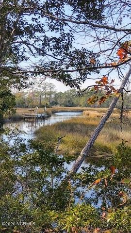 This is a beautiful location close to the Back Gate of Camp Lejeune, and only 10 minutes to Swansboro! WATER FRONT with nice scenic views. It could be a great place for a builder to split it up for several houses with up to three waterfront lots! See documents for a survey map that could become a reality! On the right day you might see some drum there for the catching if you like fishing. It would be a good place to launch a Kayak if your an outdoor enthusiast! So many possibilities! Go show it!
