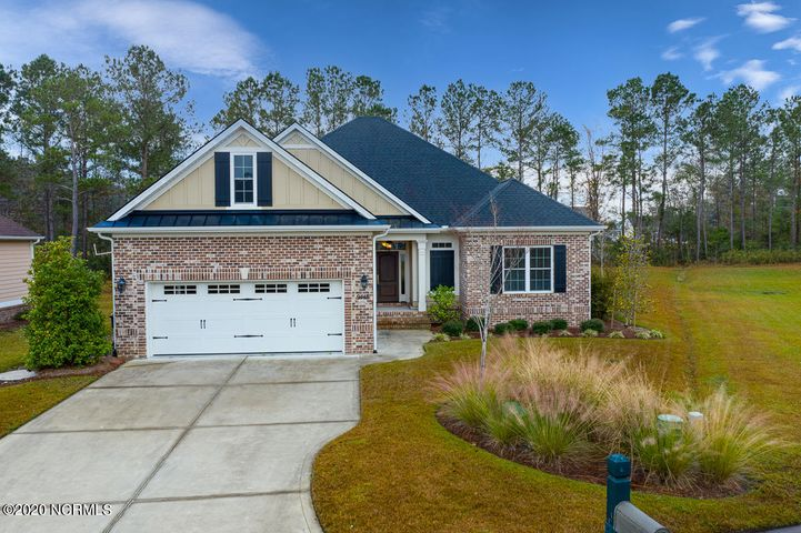 You will not want to miss this immaculate custom-built home by renowned Babb Custom Homes! This open concept craftsman home offers an abundance of natural light and space for entertaining or relaxation. Top quality materials and handcrafted finishings decorate this home to make even your morning coffees somehow seem luxurious. Get ready for endless compliments from your guests on your breathtaking coffered ceiling, detailed crown molding, and beautiful hardwood floors throughout your home. Cook like a pro in the open kitchen with granite countertops and stainless steel appliances, and unwind after a long day in the spacious master suite with a large soaking tub and walk-in shower. Begin your mornings with tranquility in your Carolina Room, with a convenient entrance right from your master bedroom. Plus, experience the world class amenities of Crow Creek, one of Brunswick County's most sought-after gated communities! A golfers paradise, enjoy living in proximity to one of the top area golf courses in the comfort of your own neighborhood, and over 40 additional golf courses within 10 miles of your home. Enjoy your weekends at the indoor and outdoor swimming pools, or the premier aerobics and workout studios. And when the coast is calling your name, take a short drive to the warm and sandy beaches of Sunset and North Myrtle Beach. This opportunity won't last long! If you'd like to experience the luxury of this home for yourself, call your agent today to schedule your private showing -- just hurry!