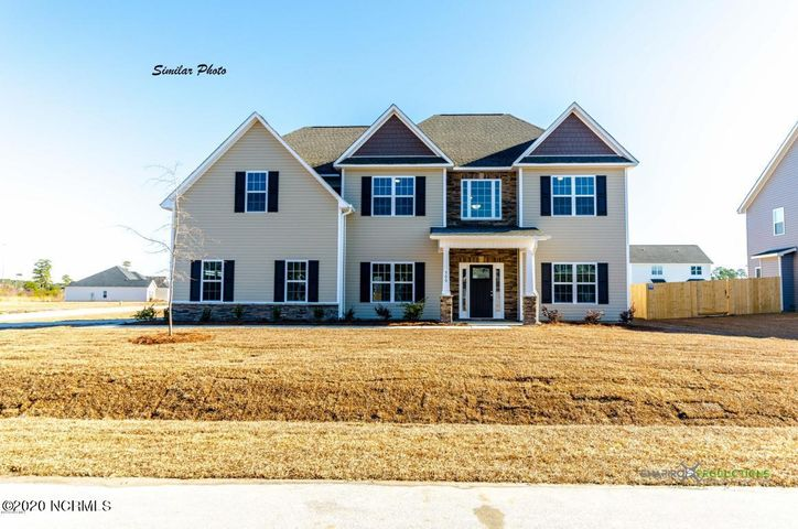 *Builder is offering $2500 in Use As You Choose! Be the first to own a Herndon B by A. Sydes Construction in Oyster Landing! This phenomenal floorplan has all the space and spaces that you have been looking for! At just under 3000 square feet, this grand home has the wow factor of your dreams. Walk in from the covered front porch and into the soaring 2 story foyer. The traditional layout of this home gives you a dedicated office/flex/sitting room space to one side and your formal dining room to the other. Further into the house you come to the wide open living space. Here, you will adore the living room with a cozy fireplace, the spacious eat in area, and the chef's kitchen with wrap around counter tops that will give you the perfect cooking and entertaining area. Upstairs you will find all of the bedrooms and the convenient laundry room. The owner's suite boasts a gorgeous tray ceiling, a fantastic sitting area, and a lovely ensuite bath featuring dual vanity sinks, a separate soaking tub from shower and a huge walk in closet! One of the secondary bedrooms has an en suite bath and a walk in closet of its own. While the other two bedrooms share a THIRD full bath! What are you waiting for? Make your appointment to see this one today before it's gone! *Buyer to verify schools. All similar photos and cut sheets are representations only. Builder reserves the right to alter floorplan and features. *This lot contains some Wetlands.