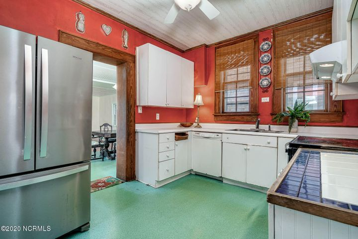 This one-of-a-kind residence, built in 1930, close to the Promise Landneighborhood of Morehead City is full of vintage charm. High ceilings and the original hardwood floors mixed with pale colors of the walls and tiled bathrooms, as well as other old school touches like built-in cabinets and mirrors lend this home its character and comfort and provide a unique beauty. This home is filled with memories of sweet and simpler times, from the families who lived here who have revelled in the benefits and benevolence of life on this Carolina seaside. With an enclosed porch upon entry, a soundside beach across the wayand water views from many of the rooms inside, living here is idyllic with space and windows and light, and an authentic, nostalgic vibe. The traditional feel continues with a formal dining room and a fireplace, and architectural elements like beadboard and crownmolding. Modern details like the stainless fridge and generous bonusroom provide flexibility for new families and friends who will want to wake up to sip coffee while watching the sunrise over the sound. This location is also near the recently improved Shevans Park on 15/16th St with tennis courts, a large playground and a picnic shelter; the 16th Street sound access with a sandy beach; the 10th St Boat Ramp which has parking, sandy beach and pier/docks; the Walter Lewis Park at the end of 12th St offers water access and picnic areas. The Downtown Waterfront area for shopping, restaurants and the Morehead City charter fishing fleet is within an easy bike ride or stroll down the sidewalks. Make this coastal cottage your new home or home away from home!