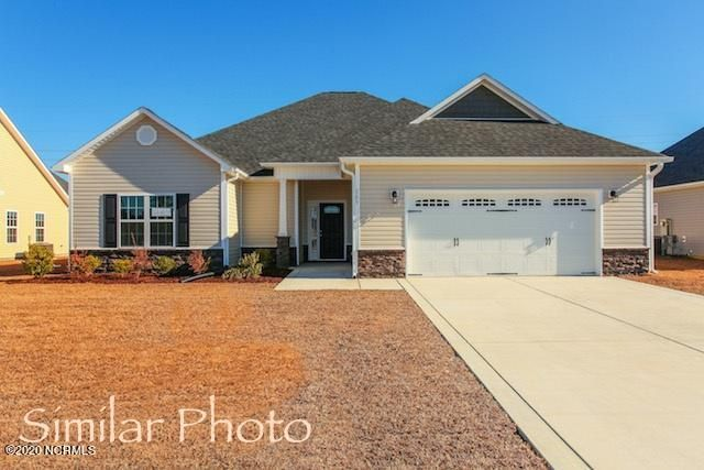 Welcome to Jacksonville's hottest new community, Stateside. Located off of Gum Branch Road behind Stateside Elementary School. All new construction by Onslow County's most trusted and preferred Builder featured in Builder 100/ Top 200 Home Builders in the country. Stateside is 16 miles to Camp Lejeune, 12 miles to New River Air Station and minutes to area schools and shopping. A beautiful new community for active and growing families.  Introducing the Raegan floor plan. Featuring 3 spacious bedrooms and 2 bathrooms at approximately 1,916 heated square feet.  The exterior is quite charming with easy-to-maintain vinyl siding accented by stone or brick. All surrounded by a sodded front yard with a clean, classic landscape. The foyer welcomes you in, opening into the expansive family room. Approximately 23'x18', the family room is perfect for gathering the entire family for movie or game night. Complete with a vaulted ceiling, ceiling fan, and an electric fireplace situated in the corner, surrounded by marble and topped with a custom mantle. The chef in the family is sure to fall in love with the kitchen! Flat panel, staggered cabinets topped with granite counters. Stainless appliances include a smooth-top range, microwave hood, and dishwasher. The spacious dining area is open to the kitchen. The master suite is located on the opposite end of bedrooms 2 and 3 for extra privacy. Approximately 17'x13', the master bedroom boasts a ceiling fan, trey ceiling, and his & her walk-in-closets. Unwind after a long day in the luxurious master bathroom. Double vanity topped with cultured marble counters, full view custom mirror, ceramic tile flooring, separate shower and soaking tub. Bedrooms 2 and 3 are approximately 13'x13' with walk-in-closets and prewired for ceiling fans. Enjoy those Carolina evenings on the covered patio. 2 car garage. All backed by a one-year builder warranty from a top, local builder. Call today! NOTE: Floor plan renderings are similar and solely representa