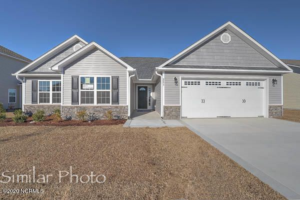 Welcome to Jacksonville's hottest new community, Stateside. Located off of Gum Branch Road behind Stateside Elementary School. All new construction by Onslow County's most trusted and preferred Builder featured in Builder 100/ Top 200 Home Builders in the country. Stateside is 16 miles to Camp Lejeune, 12 miles to New River Air Station and minutes to area schools and shopping. A beautiful new community for active and growing families.  Introducing the Vienna floor plan which features 3 bedrooms and 2 bathrooms at approximately 1,583 heated square feet. The exterior is quite charming with easy-to-maintain vinyl siding accented by stone or brick. All surrounded by a sodded front yard with a clean, classic landscape. The foyer welcomes you in, opening to the living room. Approximately 19'x14', the living room boasts a vaulted ceiling, ceiling fan, and a cozy electric fireplace surrounded by marble and topped with a custom mantle. The chef in the family is sure to fall in love with the kitchen! Ample amount of cabinet and counter space, a bar for extra seating, and a spacious pantry. Stainless appliances to include a smooth-top range, microwave hood, and dishwasher. Kitchen opens to the dining room. The master suite has an alluring trey ceiling, ceiling fan, and a HUGE walk-in -closet. Master bathroom offers a double vanity topped with cultured marble, full view mirror, ceramic tile flooring, separate shower and soaking tub. Bedrooms 2 and 3 are perfectly sized and prewired for ceiling fans. Chores are made easy with a large laundry room which leads out into the attached 2 car garage. Host BBQs on your open patio! All backed by a one-year warranty by a top, local builder. Call today! NOTE: Floor plan renderings are similar and solely representational. Measurements, elevations, and design features, among other things may vary in the final construction. Call to verify. Upcoming community amenities will include clubhouse area and community pool. Welcome Home.