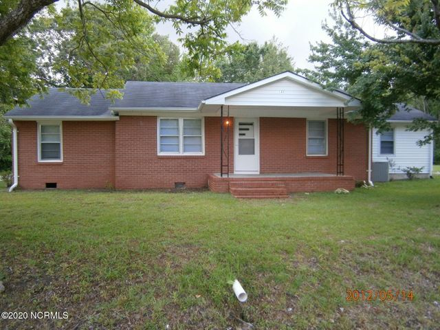 ''5'' acres just outside the city limits of Jacksonville, so NO City Taxes!!! Approximately 4 acres is still wooded for privacy but could easily be cleared to build the perfect home. One acre is clear and has a cozy, 3 bedroom 2 bath home built in 1962 but was remodeled in 2009. Home has decent living space and is being ''Sold as Is''. Has front and back porches, that are covered. Along with a 10'x12' storage building.