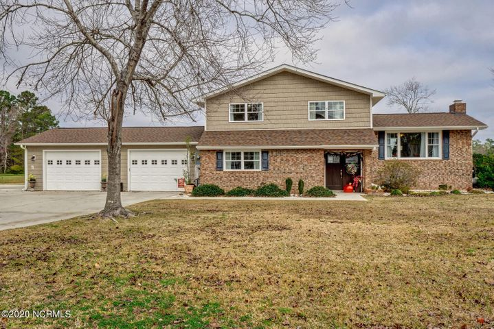 Beautiful 4 bedroom home situated on a large waterfront lot. Includes a dock with 2 boat lifts, one is a 6,000 pound lift and the other is a 10,000 pound lift. There is a separate workshop or man cave with a sink and stove.  The home was completely remodeled in 2019 with a new 50 year roof with water and ice shield on entire roof under shingles, new luxury vinyl laminate flooring, and all new paint. The first floor has a screened porch overlooking the expansive back yard with a view to the water. There is also a bedroom with ensuite bathroom, sunroom, laundry room and mudroom on this level along with the kitchen and den with a wall of windows offering a great view of the creek. Upstairs are three additional bedrooms and a formal living room with fireplace. The garage is big enough for two vehicles with extra space for storage. Don't miss the chance to see this unique waterfront gem.