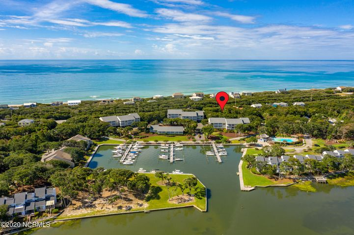 Prime building lot on Westport Drive in Beacons Reach -- this lot is located on the soundside with easy access to the Marina but is also second row ocean which is just across Salter Path Road. This beautifully landscaped community offers its owners unparalleled amenities: there are three master association pools, tennis courts, ocean and sound access points, marina with a day dock, walking/biking trails and a fitness center. Some additional minimal fees apply for the soft tennis courts and the fitness center. There is no water/sewer on site; this lot would tie into the community of Beacon's Reach Waste Treatment system and the fees would be $788/per year at present. The tap on fee is $800 per the HOA.
