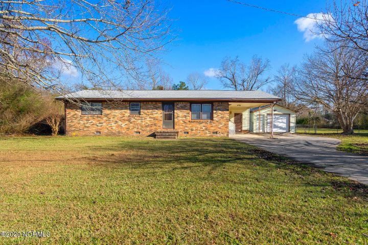 Updated 3 bedroom home with new flooring, paint, and kitchen counter tops! The detached garage and workshop is perfect for storage, hobbies, and gatherings. On .48 acres the possibilities are endless! Schedule your private tour today before this home is SOLD!