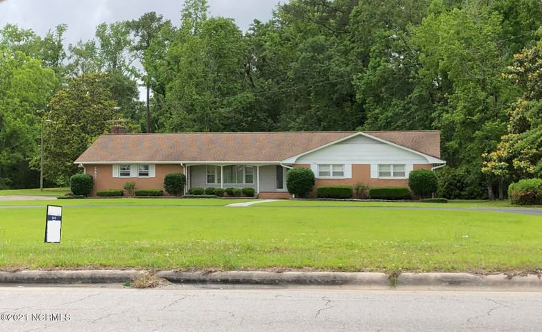 Single family home on four acres of land. Located on Richlands Hwy, this offering includes two adjoining parcels zoned Highway Business.  Improvements include a brick home.  Located just outside the Jacksonville city limits so there are no city taxes to pay.  Property is just 1.5 miles from Lowe's and WalMart.  Multiple possibilities with this property.  Call for more information today!