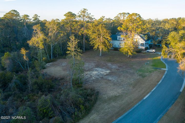 Looking for the perfect place to build your dream home? This beautiful homesite is located in the gated Olde Southport neighborhood, with convenient walking distance to the Cape Fear River, shops and dining of historic downtown Southport, or a quick drive to the warm and sandy beaches of Oak Island. Don't miss this opportunity, give us a call today!