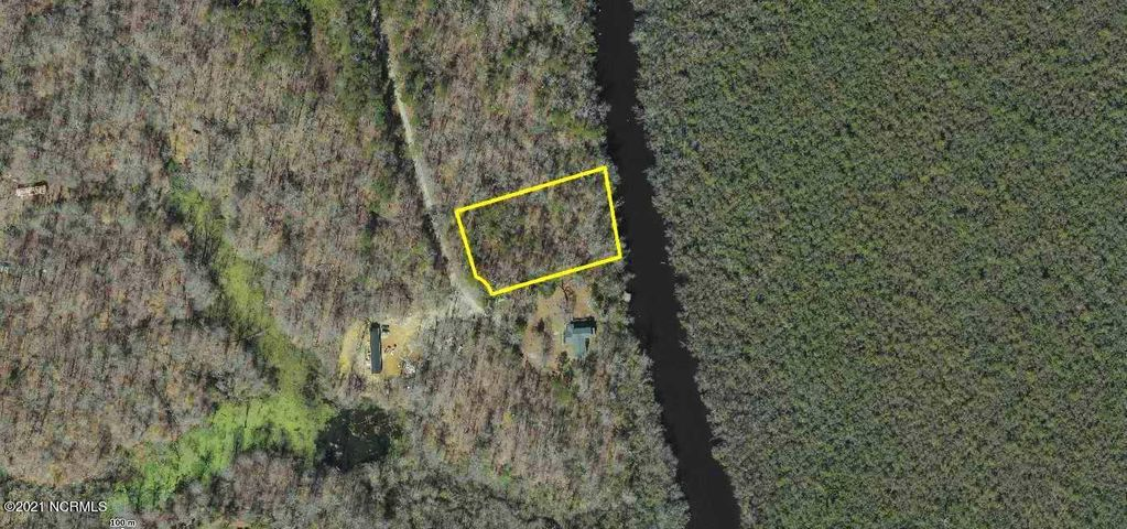 Beautiful wooded lot just waiting for you!  Located in a quiet, secluded community, this waterfront lot would be a wonderful place for you to build your new home.