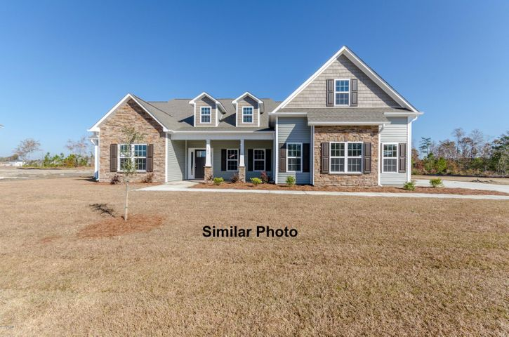 Welcome to the prestigious new home community, The Preserve at Tidewater. A coastal community. Brand new homes by Onslow County's most trusted and preferred builder, featured in Builder 100/ Top 200 Building firms in the country. This prominent neighborhood boasts a picturesque entrance, matured trees, spacious lots and a feeling of nature and serenity. Complete with an impressive clubhouse area and community pool. Introducing the Massey 3196 floor plan... where luxury meets functional. Approximately 3196 heated square feet of charm, this brand new home is sure to impress. The covered front porch is waiting for your rocking chairs and hanging baskets. Invite your guests in to the grand foyer. The formal dining room is stunning and perfect for gathering family and friends. The expansive family room is open to the kitchen and breakfast nook. The family room boasts a trey ceiling, ceiling fan, and cozy fireplace surrounded by marble and topped with a custom mantle. The chef in the family will LOVE this kitchen. Flat panel, staggered cabinets (lots of them) granite counter-tops, and stainless steel appliances to include a smooth-top range, dishwasher, and microwave hood. The kitchen is also open to the breakfast nook, a place to enjoy your morning coffee, or have breakfast with the family. The master suite comes complete with a trey ceiling, ceiling fan, and access to the back covered patio. The master bathroom boasts a double vanity topped with cultured marble counters, full view custom mirror, ceramic tile flooring, and a separate shower and soaking tub. The master bathroom leads to a huge walk-in-closet and through the walk-in-closet is the 2nd entrance to the laundry room, how convenient! Across the home you will find bedrooms 2 and 3, that share a Jack-and-Jill bathroom with linen closet. A fourth bedroom/optional study is found at the front of the home. Stairs lead to the bonus room with bathroom, the ideal space for a game room, media room, play room, office, exe