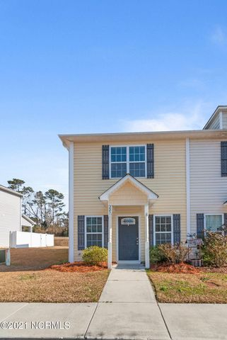 This beautiful 2 bedroom 2.5 bath townhome is move-in ready and just waiting for you to call it your new home! Downstairs in the living room you will enjoy brand new wood laminate flooring.  A beautiful arched opening will invite you into the modern kitchen with all stainless steel appliances including side by side refrigerator, dishwasher, electric smooth top range and built in microwave, and arched window with a view into the living room, a dining area and a pantry. The only carpet in this entire townhome is on the stairs and upstairs landing! Both upstairs bedrooms feature trey ceilings and ceiling fans, and the master features a Master bath with dual vanity and walk in closet. You'll also enjoy a covered back patio and storage room, in addition to a white vinyl privacy fenced backyard.  This property is located in the county so no city taxes! This one won't last long at this price, so make your appointment to view it today!